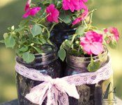Mason jars planted with flowers for favors.  Has several mason jar ideas
