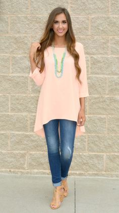 This light peach quarter-sleeve high low top is perfect for spring!