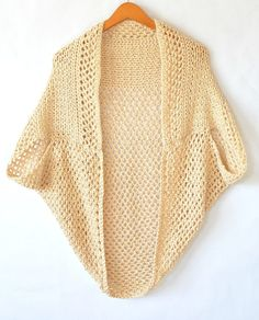 Blanket sweater/shrug/poncho crochet pattern.  Very clever - it's a large square, folded and stitched for the arm holes.  The different stitches at the top of  the square creates an interesting border around the neck edge.