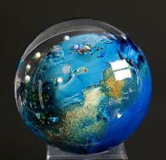 Large possibly inhabited planet - contemporary glass desk decoration. Awesome!