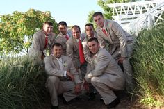 The guys had khaki suits with coral ties that matched the girls dresses.  The groom, Ty, had the same suit except with an ivory vest and tie.