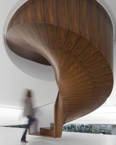 Love this spiral #staircase #covered in wood at the #CuboHouse by @isayweinfeld  Photo by @fernandogguerra by designmilk