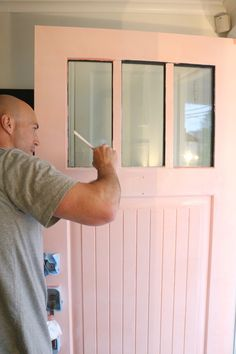 SW Coral Perfection Painted Front Door Tips and our new PINK Door - Nesting With Grace Coral Front Doors, Front Door Paint Colors, Painted Front Doors, Exterior Paint Colors, Front Door Decor, Front Porch, Coral Door, Exterior Design, Tan House