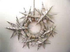Paper Stars From Upcycled Sheet Music Crafts - This link is to the site with instructions on how to make the stars.  This is the site with the star wreath but no instructions:  http://fraggierocks.blogspot.com/2011/10/christmas-star-wreath.html