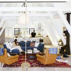 Soaring white walls balance with furnishings and textiles to underscore the modern cabin vibe.