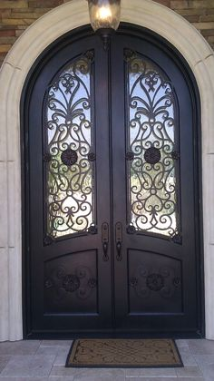 We worked hand in hand with our customers to design this custom, arch top, wrought iron door.  We think it turned out pretty fantastic!  dream home. front doors. iron doors. wrought iron. exterior design. home remodel. home building
