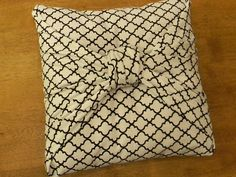 Easy pillow cover.  I just did this myself at home in less than 5 minutes.  If I like it enough, I might hand stitch it to re-inforce it.