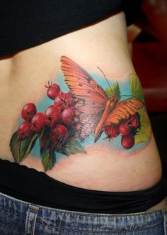 Very detailed tattoo of an orange butterfly on a vine w/ berries