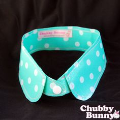 """Dotty Dot Detachable Collar - Mint  $25.00    We're just dotty for dots!    This detachable collar snaps on with a white snap button, and can be worn with a variety of tops or dresses!    Mint green with white dots, this collar is made from a stiff vinyl that won't lose its shape and will be sure to get you compliments from your friends all year long.    If you like this item, make sure to check out the Dotty Dot Bows for sale, too!    Collar measures approx. 17.5"""" long, unbuttoned, and 2""""…"""