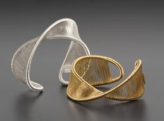Gold Bracelet - A continuous length of metal wire is wrapped around the curves of this stunning cuff. Lightweight and flexible, it adjusts to fit most wrists. Choose sterling silver or gold-filled. Silver Jewellery Indian, Silver Jewelry, Silver Earrings, Wire Jewelry Rings, Wire Jewelry Designs, Garnet Jewelry, Indian Earrings, Fall Jewelry, Feather Earrings
