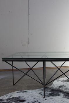 Industrial glass and black metal table from HD Buttercup.  #HDButtercupxgoop
