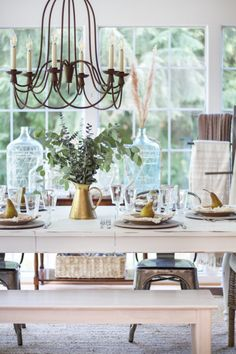 Fall home tour sharing how to get your home ready for the season with affordable touches such as this dining table set with golden pears and fresh eucalyptus.