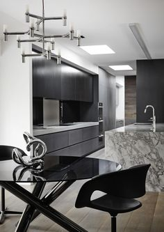 Christopher Elliott Design - Dark Cabinets and Marble Island