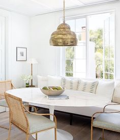 Dining Furniture Ideas : Modern eclectic dining room with brass pendant, banquette seating, and wicker dining chairs on Thou Swell Kevin O'Gara Saarinen Tisch, Mesa Saarinen, Saarinen Table, Estilo Interior, Home Interior, Scandinavian Interior, Contemporary Interior, Kitchen Interior, Interior Ideas