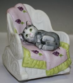 "Just #precious is how I would describe this #ceramic #musicbox of a #kitten curled up in a #wicker #rockingchair. Copywrite #Mann by #Lipp&Mann of #Japan. It plays #""Memories"" For more information visit the #showcase for Dealer S127ML on #ShowplaceonThird. nyshowplace.com/..."