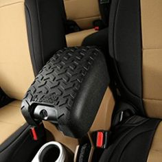 Rugged Ridge Black Center Console Cover for Jeep Wrangler JK with Tire Thread Design.