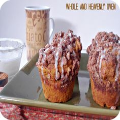 Pumpkin Pecan Streusel Muffins: Moist pumpkin-spice muffins with a crunchy pecan topping and a gooey vanilla icing--Perfect for those cold fall mornings!