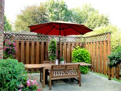 Patio made private by adding tall wood fencing. Love this style fence!