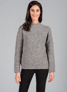 Suzanne Aran Sweater - The Suzanne sweater is a beautiful, classic addition to the Blarney Aran Originals range. It features a high neck, raglan style sleeve and hem that lends exquisite detail to a relaxed and stylish woman's sweater.