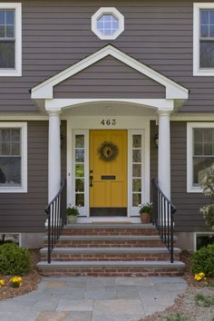 Love the pop of the yellow door - draws the eye right where you want people to look.