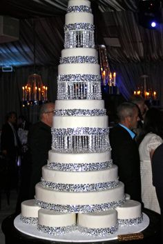 add glitter to the fondant, add initails, put lights in one tier, add fountain to other tier and make the glass beads rhinestones. That would make a perfect cake!