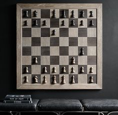 RH's Giant Wall Chess Set:The king of chessboards, our oversized wall-mounted version lends epic drama to your every move – from opening gambit to checkmate. Inspired by a vintage tabletop set and framed in solid elm, it's as much art as it is amusement. Strong magnets hold the pieces in place until you capture them. The set includes checkers, too, for twice the fun.