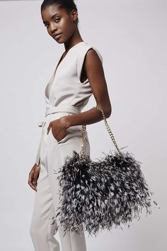 Perfect for the party season, we're loving this cute shoulder bag featuring real premium ostrich and turkey feathers, with a contrasting chunky metal chain handle. #Topshop