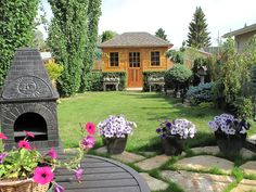 The Sonoma Shed will go along with any decorations you have at your backyard. We love the outdoor fireplace! Backyard Studio, Small Buildings, Shed Plans, Gazebo, Cabin, Decorations, How To Plan, Garden, Outdoor Decor