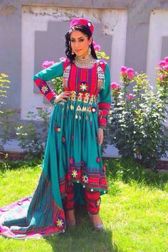 A modern Afghan Koochi dress...modeled by a  young woman of today in Kabul