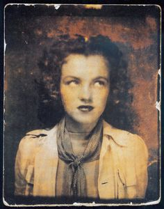 Norma Jeane Baker (later known as Marilyn Monroe) in a photobooth at age 12 in 1938