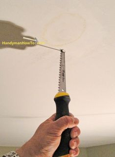 Drywall Ceiling Repair: Cut out the Water Damaged Area with Drywall Jab Saw-this tutorial is for suspended ceiling but should work for wood joists too.