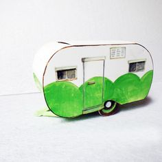 Break out the paints and pencils! The 3-D Travel Trailer from Eileen Hull's Vintage Travel Sizzix collection was just begging Mou Saha at Collage Collage Collage to whip out the brushes, illustrate and bring it to life!