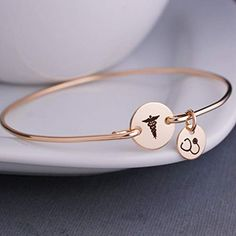 # getting into nursing school Amazing offer on Caduceus Bangle Bracelet Gold Graduation Gift Nurse Stethoscope Charm Medical School Graduation Gift, Nursing School Graduation Gift online - Theveryhotnew Medical Gifts, Nurse Gifts, Nurses Week Gifts, Happy Nurses Week, Sneaker Pink, Gold Bangle Bracelet, Medical School, Cute Jewelry, Gold Jewelry