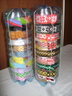 for your ribbons: this appears to be two 2-liter bottles, tops cut off, fitted together, then with an open slot cut down the side.  Separate bottles, insert spools, leaving a tail dangling out of the slot. Reattach top piece.