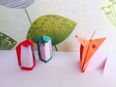 Paper craft origami penguins and fox