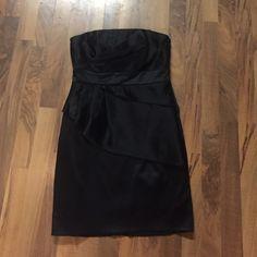 Little Black Dress Size 4 White House Black Market strapless black dress.  Side zip closure. 98% polyester, 2% spandex (lining 95/5).  Item# D125. White House Black Market Dresses Strapless