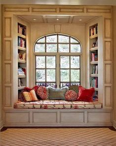 Bay Window Design With Built In Bookcases And Seating And Casement Windows With Arched Top