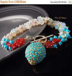 The Sonnet Bracelet is a bold and elegant cluster-style design with intense ombré colors. The Sonnet features iridescent, smooth-polished Ethiopian opal rondelles (with dazzling flashes of pink and blue!), faceted Sleeping Beauty turquoise rounds, and faceted Mexican fire opal in a true red-orange hue. The bracelet closes with a gold fill toggle clasp that been accented with a turquoise pavé charm to dangle delicately at your wrist. Measurements - Length: Currently 8 inches long Turquoise…