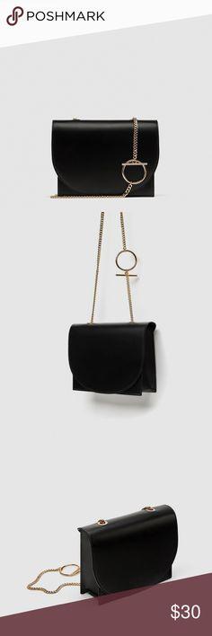 Zara CrossBody Black Leather Bag With Gold Chain Black faux leather cross body bag with amazing circle hook chain detail.  So elegant. Perfect Size.   WEAR FROM DAY TO NIGHT  Height x Width x Depth: 19 x 26 x 7 cm. / 7.4 x 10.2 x 2.7″ Zara Bags Crossbody Bags