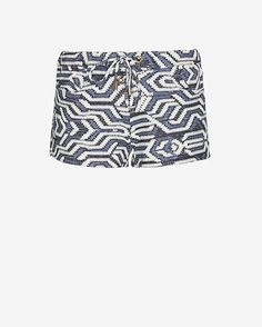 Melissa Odabash Shelly Ikat Print Lace Up Shorts: A very eyecatching navy and white ikat print on these low rise hipster shorts. Side pockets and front lace up ties accented with gold-tone logo-engraved metal cord ends. In navy/white. Fabric: 60% Viscose/20% Acrylic/15% Polyester/4% Polyamide/ 1% ...