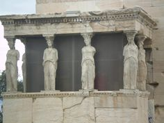 Replica's of the Six Girls on the erechtheion at the Acropolys in Athens, Greece.  The Six Girls show how females can hold a society up in it's gold Period