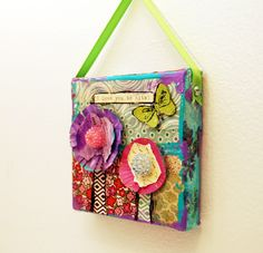 "This cute mini mixed media original art on canvas has purple and pink flowers with beaded jeweled centers and chevron stems. The art reads "" I Love you to bits"" making it great for Valentine's day or another special occasion. The colorful collage art painting has a bright chartreuse green glittery butterfly and a chartreuse green ribbon to hang it on a wall or from a kitchen cabinet knob or a dresser knob. The petite size also makes a great desk ornament. This makes a creative gift for women…"