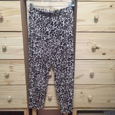 Leopard Jersey Harem Jogger Pants H&M harem/jogger pants in leopard print. Pockets as shown in pictures. Get slimmer towards the ankles. Super cute with a black tee and gladiators. I think these are meant to be worn at your hips, but I wore them high waisted and they were fine as well. Worn a few times, perfect condition. H&M Pants Track Pants & Joggers