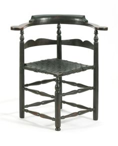 """ANTIQUE AMERICAN QUEEN ANNE SPLINT-SEAT CORNER CHAIR New England, Mid-18th Century In a hardwood under original early dark finish. Boldly proportioned with large arm rests, horizontal splat back and turned legs joined by stretchers. Overall height 30.75"""". Seat height 17""""."""