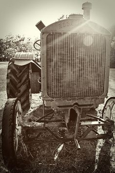 Old farm equipment is so interesting to me. I googled it.. this is a1929 Rock Island Model G-2 15-25