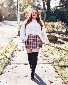 d5ad45f3388e All about plaid skirts and cable knit sweaters. Paired with wide calf over  the knee boots that are perfect for curvy girls.