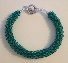 Green glass beaded Kumihimo bracelet by Jewellery by Janine https://www.facebook.com/JewelleryByJanine