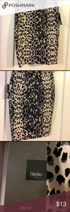 ✨SALE✨✨ NWT Size 4 black/tan pencil skirt NWT Size 4 Women's black/cream Mossimo animal print pencil skirt. Falls just below knee, front pockets, slit at bottom back hem, back zip closure. Mossimo Supply Co. Skirts Pencil