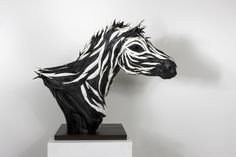WOW - incredible scuptures by Yong Ho Ji using tires!  Love it!