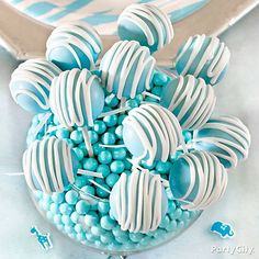 Baby blue cake pops with stripey white drizzles - perfect for a blue safari baby shower theme
